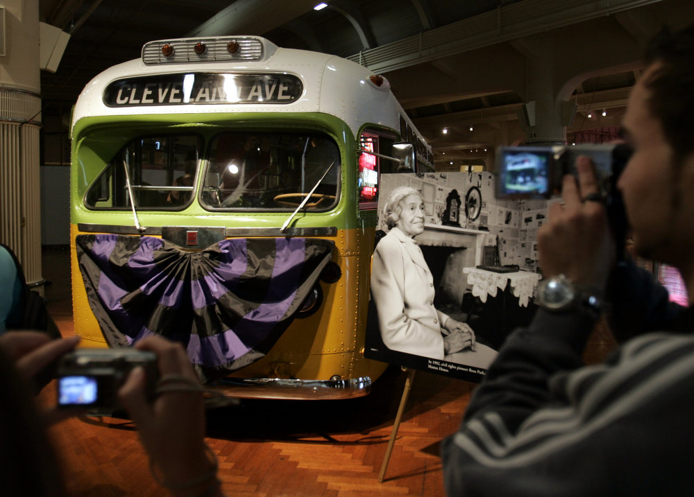 Description of . Julian Rehm of Freudenstadt, Germany, right, photographs the bus that Rosa Parks rode when she refused to yield to a white man a half-century ago, at the Henry Ford Museum in Dearborn, Mich., Tuesday, Oct. 25, 2005. (AP Photo/Carlos Osorio)
