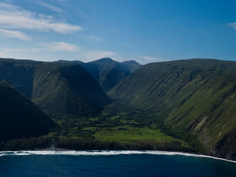 The gorgeous Waipio Valley, Check out the wiki link for more information on this stunning place: http://en.wikipedia.org/wiki/Waipio_Valley