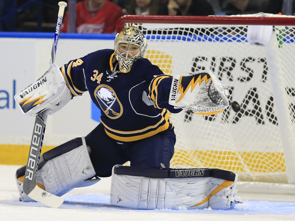 . Buffalo Sabres goaltender Michal Neuvirth (34) makes a save against the Detroit Red Wings during the first period of an NHL hockey game, Sunday, Nov. 2, 2014, in Buffalo, N.Y. (AP Photo/The Buffalo News, Harry Scull Jr)