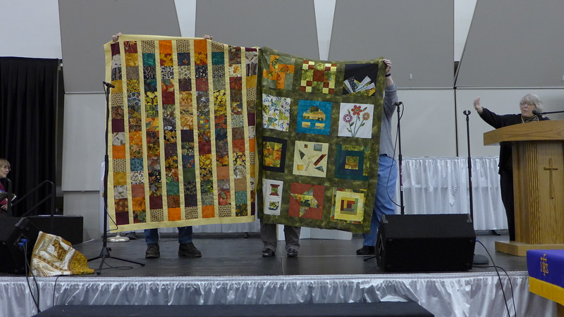Jan Babcock showed two quilts made by the Creative Cutups.  The quilt on the right is from Blotto Blocks from National Quilt Day .  Both tops are being given to Bobbi Slider..