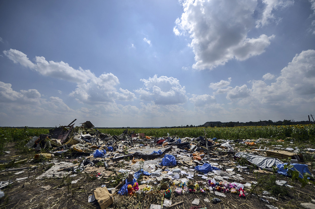 . A photo taken on July 23, 2014 shows the crash site of the downed Malaysia Airlines flight MH17, in a field near the village of Grabove, in the Donetsk region. AFP PHOTO/ BULENT  KILIC/AFP/Getty Images