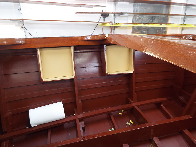 Leather upholstery installed in the storage compartments.