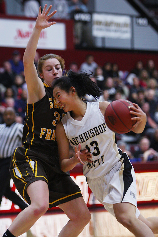 . Mitty\'s Regina Chi drives in on St. Francis\' Jennifer Lucian in the first quarter during the CCS Open Division girls basketball finals at Santa Clara University in Santa Clara, Calif. on Saturday, March 2, 2013. The Archbishop Mitty Monarchs played the Saint Francis Lancers. (Jim Gensheimer/Staff)