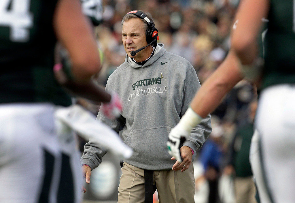 . Michigan State head coach Mark Dantonio congratulates his team while playing Purdue during the first half of an NCAA college football game in West Lafayette, Ind., Saturday, Oct. 11, 2014. (AP Photo/AJ Mast)
