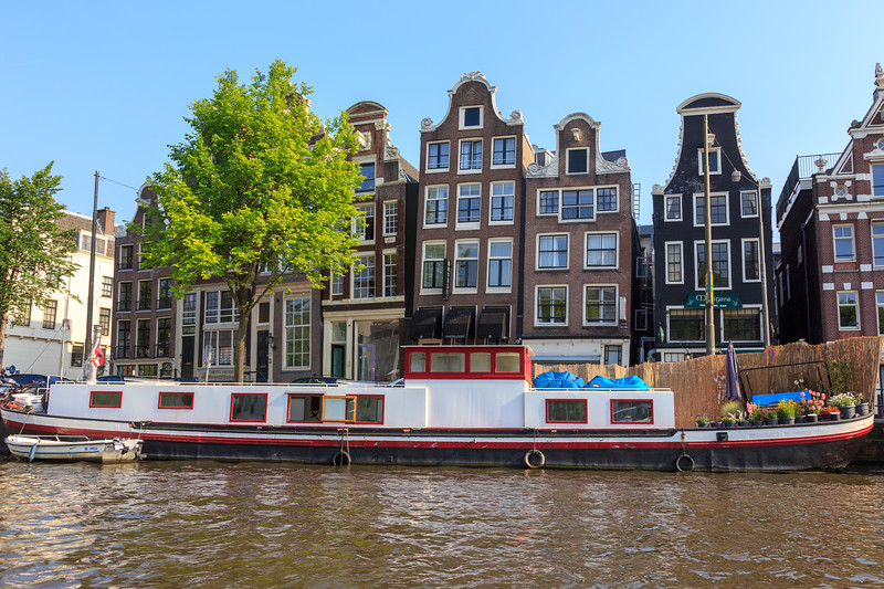 Houseboat with Crooked Row Homes in Amsterdam