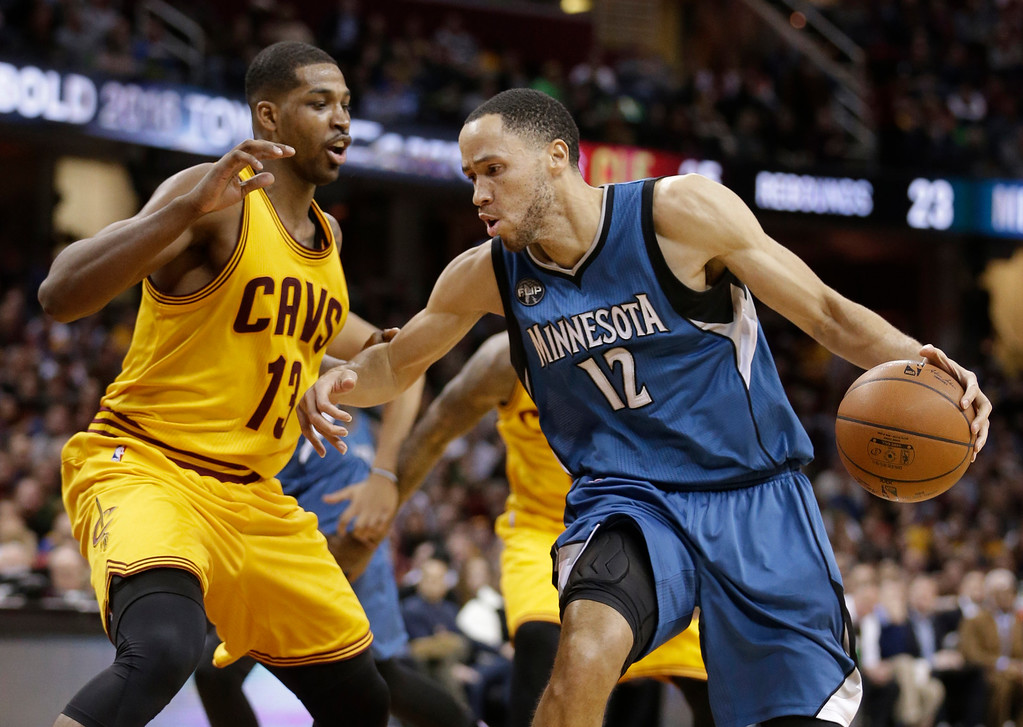 . Minnesota Timberwolves\' Tayshaun Prince (12) drives past Cleveland Cavaliers\' Tristan Thompson (13), from Canada, in the second half of an NBA basketball game, Monday, Jan. 25, 2016, in Cleveland. The Cavaliers won 114-107. (AP Photo/Tony Dejak)