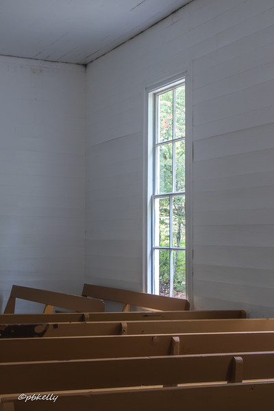 100818.  Pews and window.