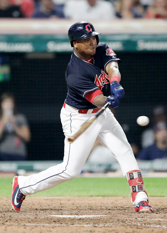 . Cleveland Indians\' Jose Ramirez hits a two-run double off Minnesota Twins relief pitcher Gabriel Moya in the sixth inning of a baseball game, Tuesday, Aug. 28, 2018, in Cleveland. Greg Allen and Francisco Lindor scored on the play. (AP Photo/Tony Dejak)