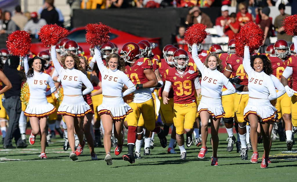 . LAS VEGAS, NV - DECEMBER 21:  USC Trojans Song Girls run onto the field with the team before their game against the Fresno State Bulldogs in the Royal Purple Las Vegas Bowl at Sam Boyd Stadium on December 21, 2013 in Las Vegas, Nevada. USC won 45-20.  (Photo by Ethan Miller/Getty Images)