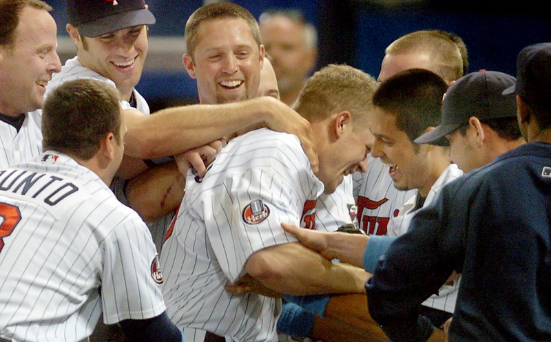 . Teammates pile on Twins hitter Justin Morneau (center) after he hit a lead-off home run in the bottom of the ninth inning to beat the Milwaukee Brewers, 10-9, at the Metrodome in Minneapolis on Sunday June 17, 2007.  (Richard Marshall, Pioneer Press)   sd6/17/07c