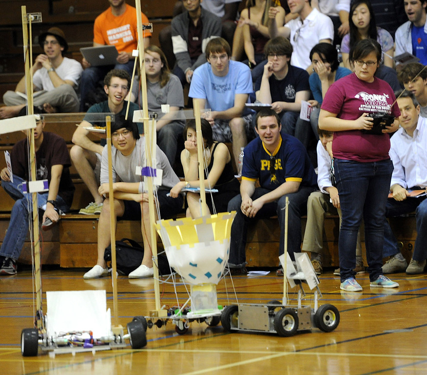 """. One of the most popular annual events at Caltech is back. This year\'s 28th Annual ME72 Engineering Design Contest, \""""Sponge Wars Attack of the Drones\"""" at Caltech Brown Gym Tuesday, March 13, 2013. Mechanical Engineering 72 competition features teams maneuvering kitchen sponges into a goal with a pair of autonomous robotic vehicles � and preventing opposing teams from doing the same. Six teams  competed head-to-head in a series of rounds. The team with the most points at the end of each heat wins. The victors earn the admiration of the crowds in the stands and are honored with the ME-72 trophy. (Photo by Walt Mancini/SXCity)"""