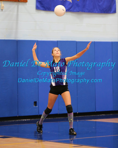 Hampton Bays Volleyball action shots from the Mattituck HS Volleyball Tournament. 9-28-13