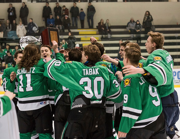 DAVID LIPNOWSKI / WINNIPEG FREE PRESS  The Murdoch Mackay Clansmen celebrate winning the boys high school hockey C division championship series against the Linden Christian Wings Wednesday March 8, 2017 at MTS Iceplex.