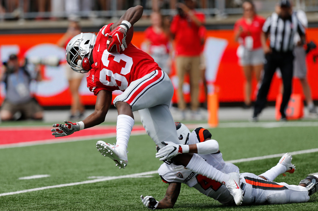 . Oregon State defensive back Dwayne Williams, right, tackles Ohio State receiver Terry McLaurin during the first half of an NCAA college football game Saturday, Sept. 1, 2018, in Columbus, Ohio. (AP Photo/Jay LaPrete)