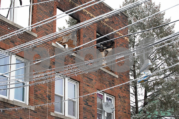 01/17/18 Wesley Bunnell   Staff The New Britain Fire Department battled a structure fire at 42 Connerton St. starting late on Tuesday night and continued into Wednesday morning. The building sustained severe damage with with interior structural collapse and a total roof collapse. One firefighter was injured and transported to the hospital for observation and released. Ice and sneakers can be seen hanging from the utility lines leading to the building along with parts of the collapsed roof seen through the top windows.