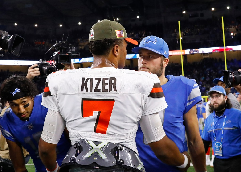 . Cleveland Browns quarterback DeShone Kizer (7) greets Detroit Lions quarterback Matthew Stafford (9) after their NFL football game, Sunday, Nov. 12, 2017, in Detroit. (AP Photo/Rick Osentoski)
