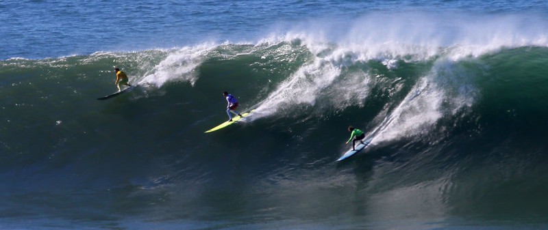 . Surfers Colin Dwyer, left, Anthony Tashnick, center, and Grant Baker ride a wave during the fourth heat of the Mavericks Invitational on Sunday, Jan. 20, 2013 near Half Moon Bay, Calif.  (Aric Crabb/Staff)