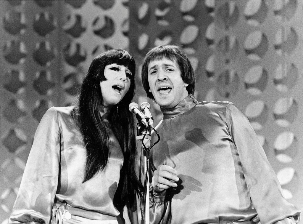 ". Entertainers Sonny, right, and Cher sing during taping of ""The Danny Thomas Special\"" in Los Angeles, Ca., on Jan. 21, 1966.  (AP Photo)"