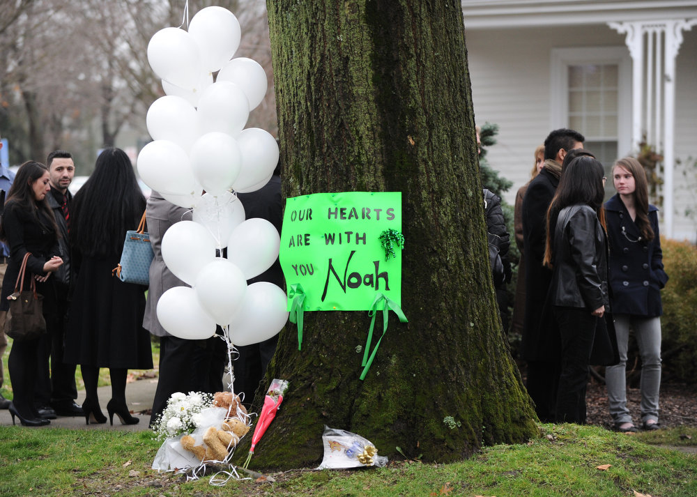 . A sign and balloons outside the funeral home where services were held for six year-old Noah Pozner, who was killed in the December 14, 2012 shooting massacre in Newtown, Connecticut, at Abraham L. Green and Son Funeral Home on December 17, 2012 in Fairfield, Connecticut. Today is the first day of funerals for some of the twenty children and seven adults who were killed by 20-year-old Adam Lanza on December 14, 2012.  AFP PHOTO / Don  EMMERT/AFP/Getty Images
