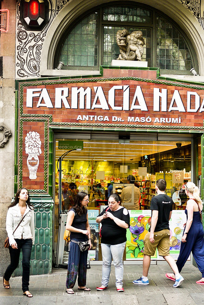 The pretty storefront and carvings of the local pharmacy in Barcelona, Spain.