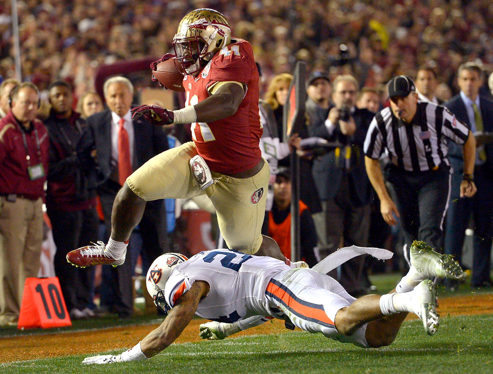 . Florida State\'s Chad Abram goes for a fourth quarter score against Auburn during the 2014 Vizio BCS National Championship January 6, 2014 in Pasadena CA.  Florida State won the game 34-31.(Andy Holzman/Los Angeles Daily News)