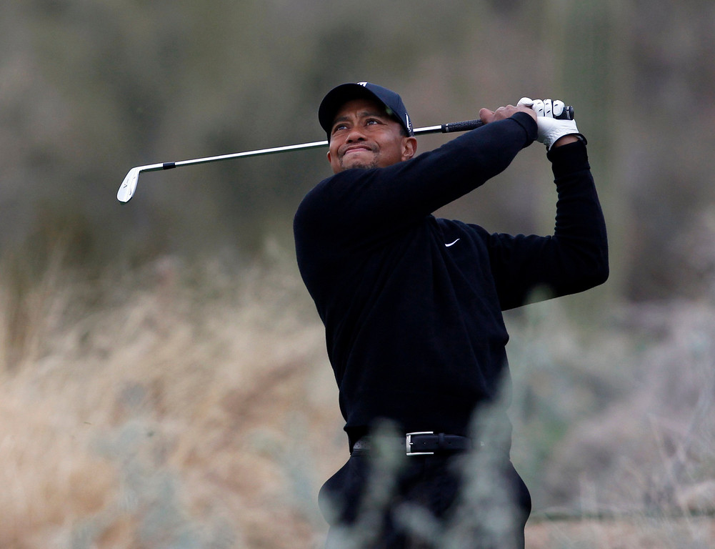 . Tiger Woods of the U.S. hits off the 12th tee against Charles Howell III of the U.S. during the weather delayed first round of the WGC-Accenture Match Play Championship golf tournament in Marana, Arizona February 21, 2013. REUTERS/Matt Sullivan