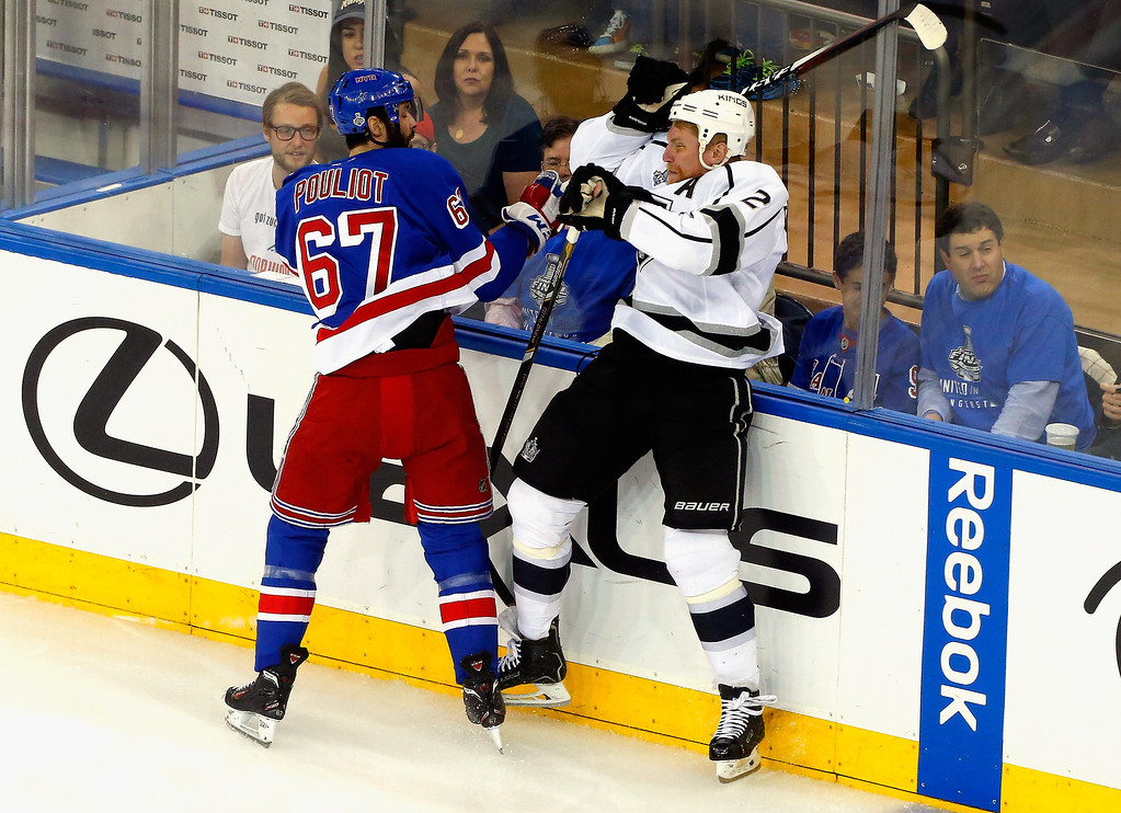 . Benoit Pouliot #67 of the New York Rangers checks Matt Greene #2 of the Los Angeles Kings during the first period of Game Three of the 2014 NHL Stanley Cup Final at Madison Square Garden on June 9, 2014 in New York, New York.  (Photo by Jim McIsaac/Getty Images)
