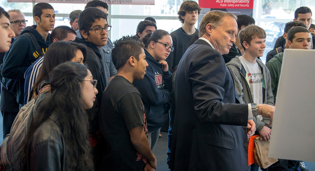 . Former LAPD member, now with Raytheon Mike Bostic speaks to Warren High School students during their visit to Raytheon\'s Public Safety Facility in Downey for demonstrations of the company\'s electronic communications equipment March 6, 2013.  (SGVN/Staff photo by Leo Jarzomb)