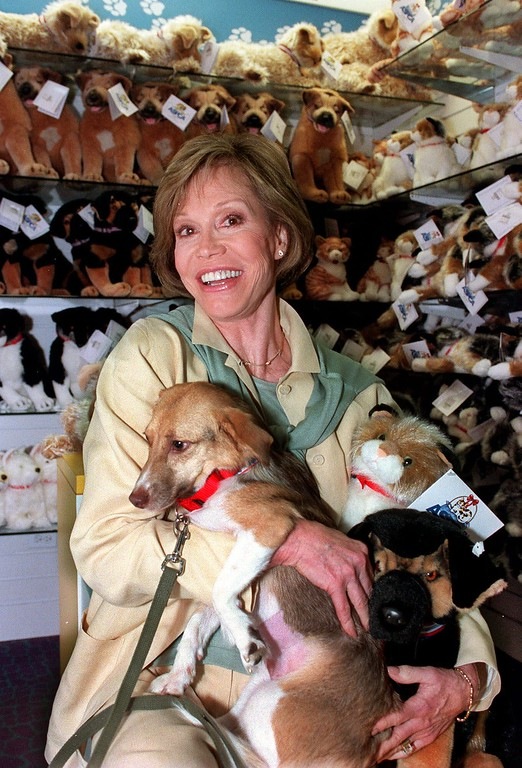 . Actress and animal advocate Mary Tyler Moore holds Samantha, 1 1/2 year old Shelty Beagle, at the launch of the American Society for the Prevention of Cruelty to Animals\' new line of plush toys at FAO Schartz Thursday, Aug. 5, 1999, in New York. The new line was designed exclusively for the store to raise awareness for the millions of of animals in need of shelter. (AP Photo/Marty Lederhandler)