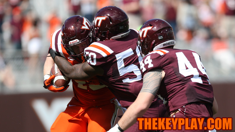 FB Sam Rogers tries to break a tackle by Jamieon Moss (50). (Mark Umansky/TheKeyPlay.com)