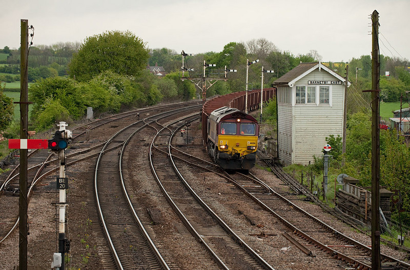 EWS 66250 with the 6T22 07:46 Immingham-Santon loaded iron ore passes Barnetby East.
