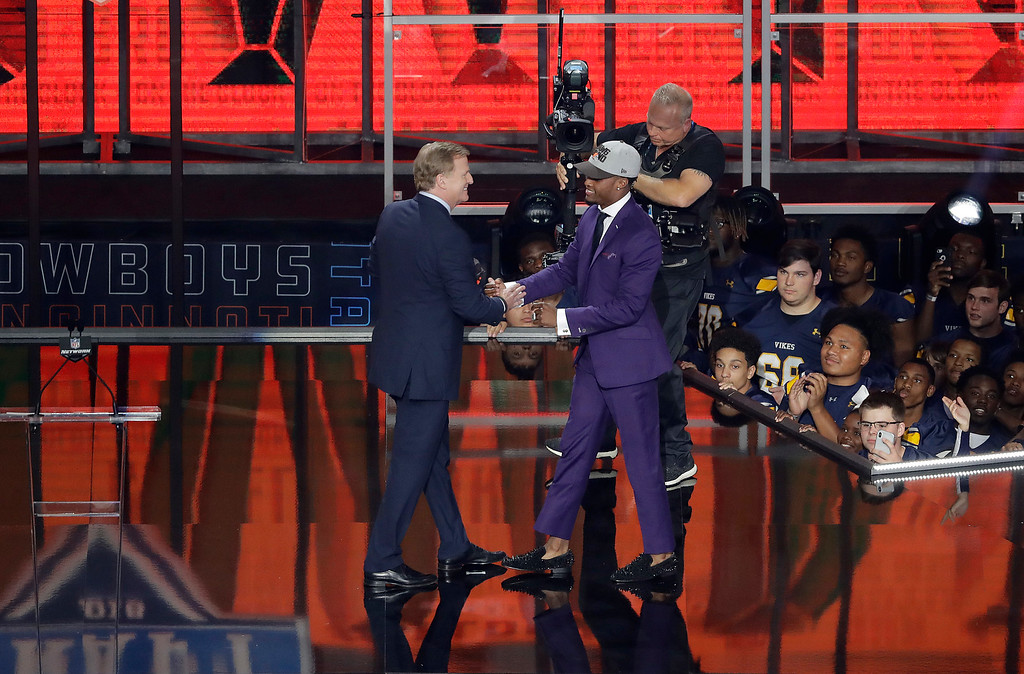 . Commissioner Roger Goodell, left, greets Ohio State\'s Denzel Ward after Ward was picked by the Cleveland Browns during the first round of the NFL football draft, Thursday, April 26, 2018, in Arlington, Texas. (AP Photo/Eric Gay)