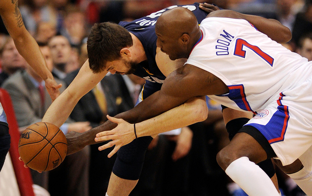 . The Clippers\' Lamar Odom #7 knocks the ball away from the Grizzlies\' Marc Gasol #33 drawing the foul during their first round Western Conference Playoff game at the Staples Center in Los Angeles Saturday, April 20, 2013. (Hans Gutknecht/Staff Photographer)