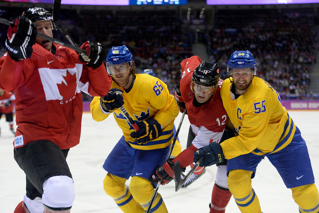 . Ryan Getzlaf (15) of Canada gets pushed by Erik Karlsson (65) of Sweden as Patrick Marleau (12) of Canada and Niklas Kronwall (55) of Sweden get physical during the third period of Canada\'s 3-0 win in the men\'s ice hockey gold medal game against Sweden. Sochi 2014 Winter Olympics on Sunday, February 23, 2014 at Bolshoy Ice Arena. (Photo by AAron Ontiveroz/ The Denver Post)