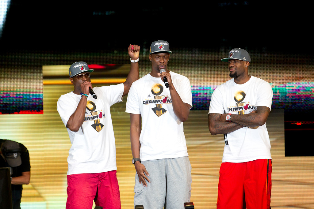 . Miami Heat players Dwyane Wade, Chris Bosh and LeBron James, right, during the public celebration for the team winning the NBA Championship in Miami, June 25, 2012. (AP Photo/J Pat Carter)