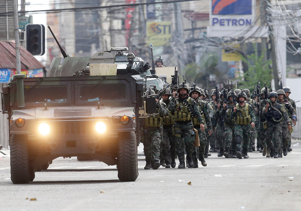 . Fresh troops arrive to reinforce other government troopers as they continue their assault at Muslim rebels Thursday, Sept. 12, 2013 in Zamboanga city in southern Philippines.  (AP Photo/Bullit Marquez)