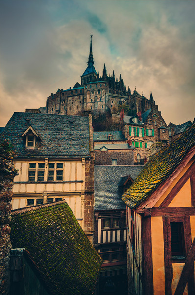 The Towering Old Village Aren't medieval places the best? Yes! I wonder what it would be like to live here all the time. Maybe you'd get tired of how charming and Hansel & Gretel everything is all the time… I doubt it though!Around this old monastery of Mont Saint Michel is a curtain wall where you can easily walk along the top. It's quite cool because every few steps there is a good view of the village and the tower above, each view offering another good photo op. - Trey RatcliffClick here to read the rest of this post at the Stuck in Customs blog.