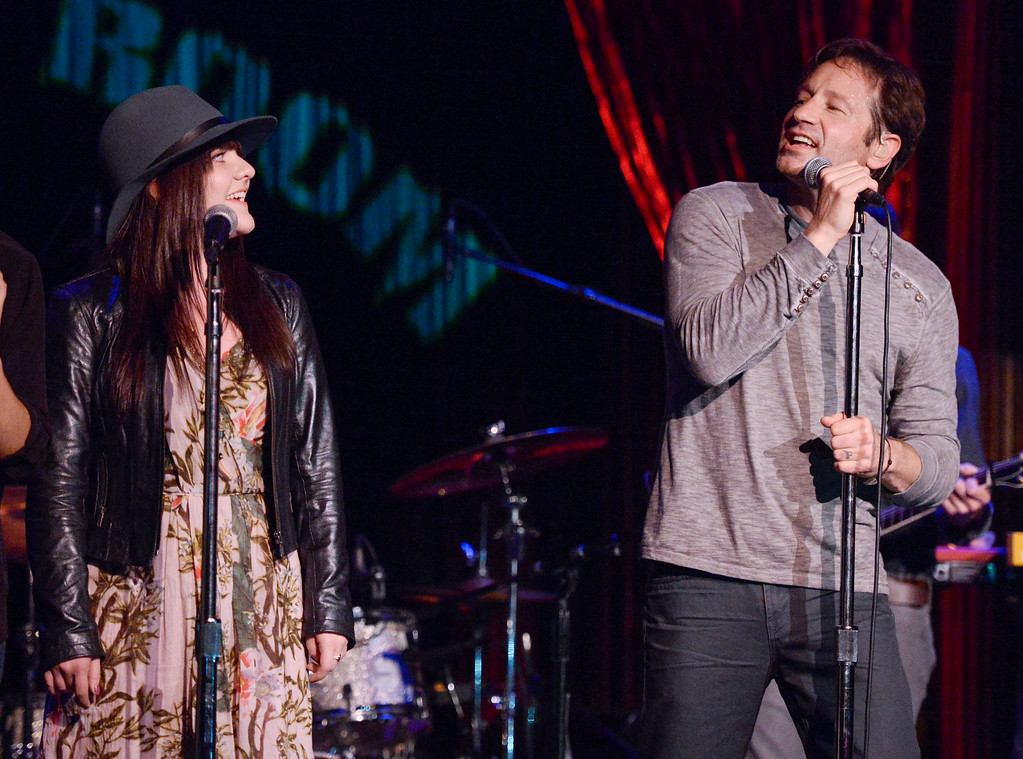 """. David Duchovny is joined by \""""Californication\"""" co-star Madeleine Martin during his performance at The Cutting Room, to promote the release of his debut album \""""Hell Or Highwater\"""", on Tuesday, May 12, 2015, in New York. (Photo by Evan Agostini/Invision/AP)"""