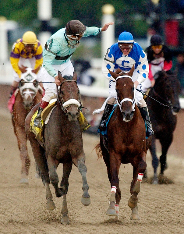 . In this June 5, 2004, file photo, jockey Edgar S. Prado, left, aboard Birdstone, reacts after winning the Belmont Stakes horse race as jockey Stewart Elliott, right, aboard Kentucky Derby and Preakness winner Smarty Jones, watches at Belmont Park in Elmont, N.Y. Early duels with Rock Hard Ten and Eddington along the backstretch proved to be Smarty\'s undoing, as the horse would go on to tire in the stretch and be caught in the final 70 yards by 36-1 long shot Birdstone. (AP Photo/Frank Franklin II, File)