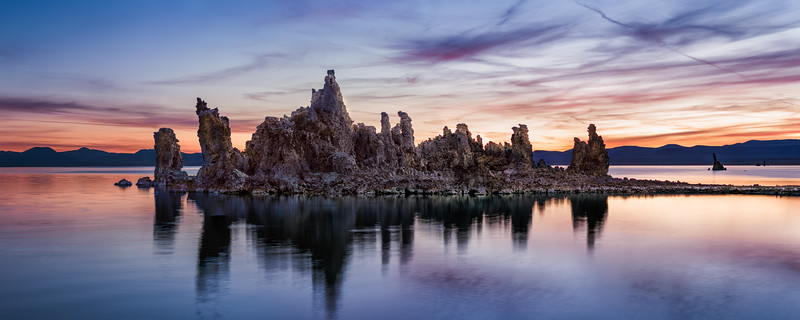 I made this image in the fall of 2016 using my Nikon D810. This was my second trip to Mono Lake in the Eastern Sierra, and I knew that the morning blue hour could be magical. That meant arriving early in the morning and hiking to the half mile or so in the dark. Normally not a problem, but it was about 5F! Fortunately I had some warm clothes with me, but I was definitely not prepared for how cold it was this morning. That said, the sunrise was absolutely incredible, and I'll never forget sharing it with a group of retired film photographers, all shooting large format film. The oldest was in his 90's and still using 8x10. It was very inspirational. This image combines 5 vertical images and cropped into 6x17 panoramic format. It can easily print up to 10-12 feet wide.