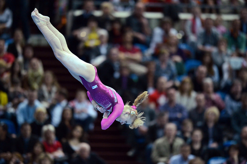 . Russia\'s Anastasia Grishina competes on the floor in the women\'s apparatus artistic gymnastics  finals during  the 5th European Men\'s and Women\'s   Artistic Gymnastic Individual  Championships in Moscow on April   21, 2013. Russia\'s Kseniia Afanaseva  took the first place, Romania\'s Larisa Andreea Iordache took the  second place and Romania\'s Diana Laura Bulimar took the third  place. NATALIA KOLESNIKOVA/AFP/Getty Images