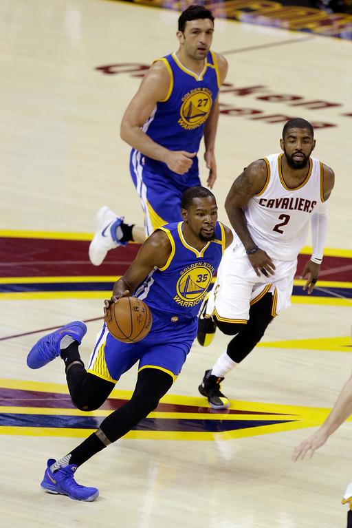 . Golden State Warriors forward Kevin Durant (35) drives on Cleveland Cavaliers guard Kyrie Irving (2) during the first half of Game 3 of basketball\'s NBA Finals in Cleveland, Wednesday, June 7, 2017. (AP Photo/Tony Dejak)