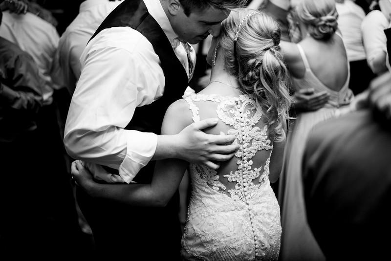 Sweet whispers between newlyweds Andrea & Eric @ Wyndrige