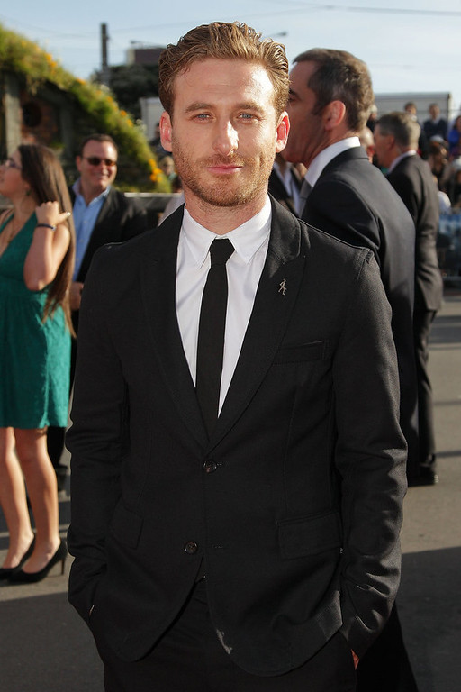 ". Dean O\'Gorman, who plays Fili, arrives at the ""The Hobbit: An Unexpected Journey\"" World Premiere at Embassy Theatre on November 28, 2012 in Wellington, New Zealand.  (Photo by Hagen Hopkins/Getty Images)"