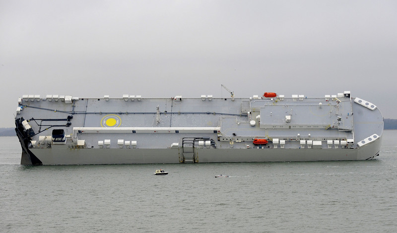 . Rescue craft float next to the grounded Hoegh Osaka cargo ship on the Bramble Bank in the entrance of the Southampton Waters in between Southapton on the southern English coast and the Isle of Wight on January 4, 2015.  RNLI lifeboats joined a multi-agency rescue when a large cargo ship grounded on the Bramble Bank in the waters south of the southern English city of Southampton. The car carrying cargo ship ran aground in the evening on January 3 with all 24 crew airlifted to safety. The ship was was heading to Germany from Southampton laden with its cargo of vehicles. AFP PHOTO / MALCOM WELLSMALCOLM WELLS/AFP/Getty Images