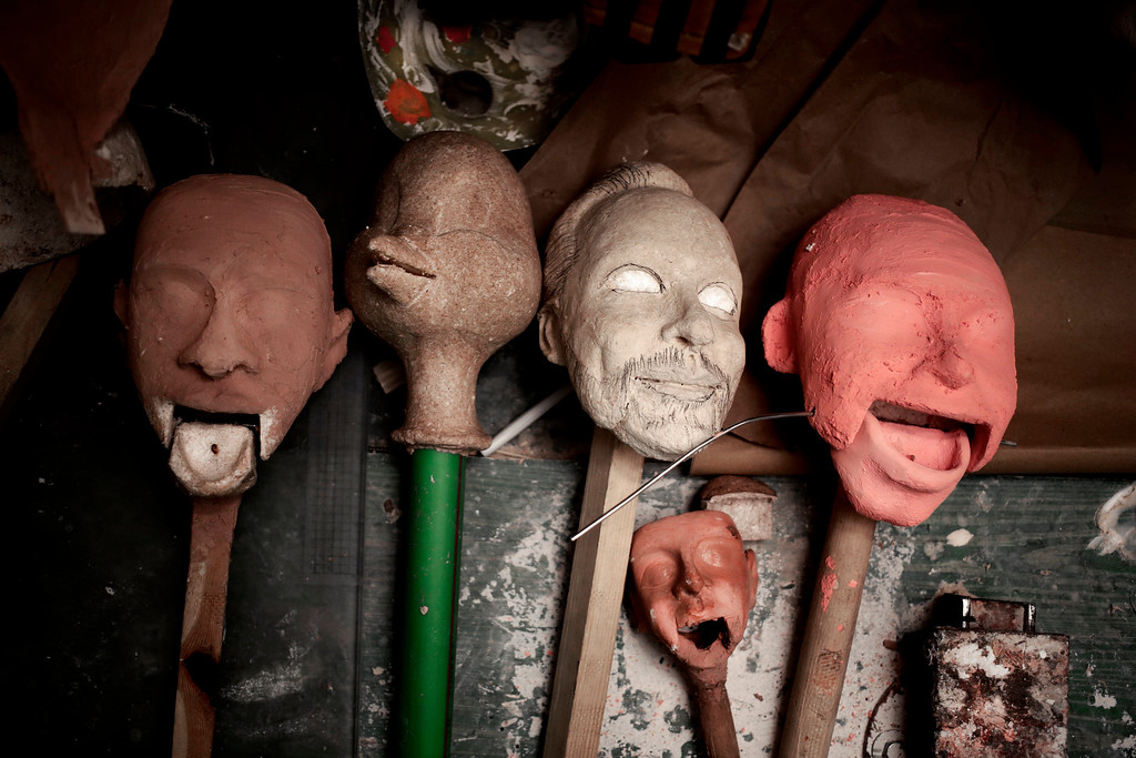 . In this April 24, 2018 photo, sculptures of puppet faces made by Egyptian artist Mohamed Fawzi Bakkar, lay on a table at his workshop, in Cairo, Egypt. Bakkar designs and builds marionettes from scratch, hoping to revive a traditional art. The 32-year-old spends hours or even days designing puppets inspired by Egyptian life -- farmers, street vendors, butchers and the occasional celebrity. (AP Photo/Nariman El-Mofty)