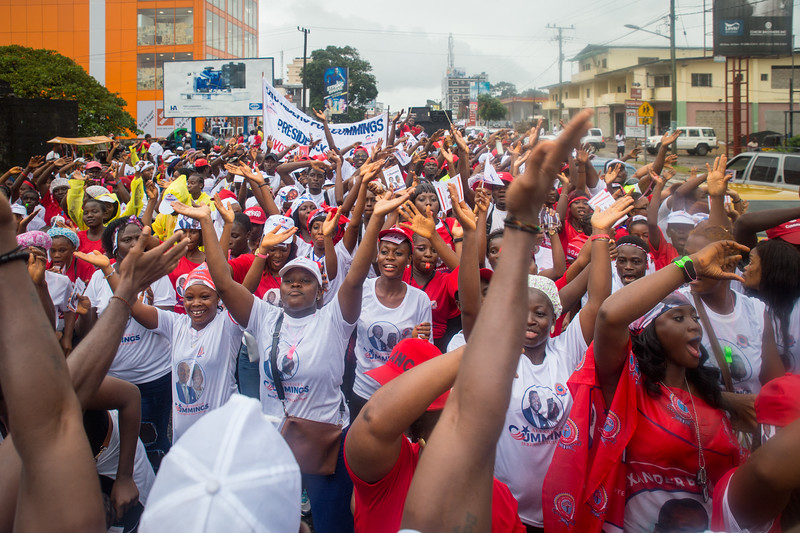Monrovia, Liberia October 7, 2017 -  Supporters parade through rain soaked streets prior to the 2017 election.