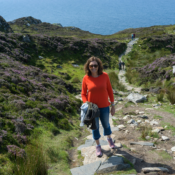 Woman walking on trail, Bunglass Point, County Donegal, Ireland