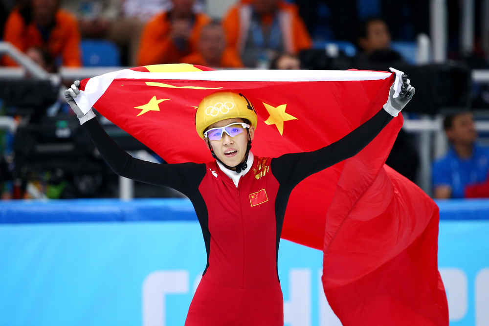 . Kexin Fan of China celebrates winning the silver medal in the Short Track Women\'s 1000m Final A on day fourteen of the 2014 Sochi Winter Olympics at Iceberg Skating Palace on February 21, 2014 in Sochi, Russia.  (Photo by Ryan Pierse/Getty Images)
