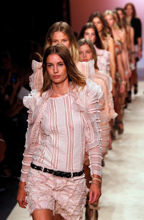 . Models wear creations for Isabel Marant\'s ready-to-wear Spring/Summer 2014 fashion collection, presented in Paris, Friday, Sept.27, 2013. (AP Photo/Jacques Brinon)
